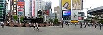 C11 292 steam locomotive and Shimbashi Station - panorama - aug 27 2015.jpg
