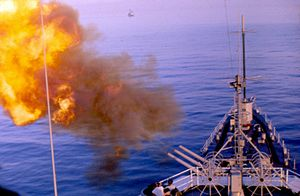 USS Oklahoma City (CL-91) - Performing fire support off Vietnam.