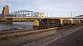CSX train crossing under the Smithfield Bridge in Pittsburgh (9382313814).jpg