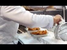 Preparing beignets in Café du Monde (New Orleans)