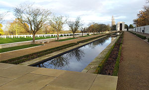Cambridge American Cemetery and Memorial - Reflecting pool leading to chapel, and memorial wall on the right.