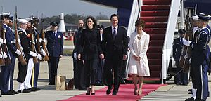 State visits to the United States - David Cameron walks down the red carpet during a flight line arrival ceremony in 2012. On the right is Capricia Marshall, Chief of Protocol of the United States.
