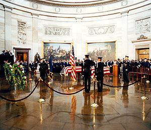 1998 United States Capitol shooting incident - A Capitol Police Honor Guard salutes the coffins of Officer Jacob Chestnut and Detective John Gibson in the Capitol Rotunda as they lie in repose.