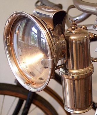 Carbide lamp - A French manufactured acetylene gas lamp, of circa 1910, mounted on a bicycle