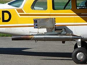 Cessna 210, rebuilt for cloud seeding, with de...
