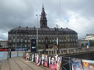 Folketing - Christiansborg Palace, the seat of the three branches of government: the Folketing, the Prime Minister's Office and the Supreme Court. Here it is surrounded by posters, a typical scene during an election season.