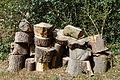 Churchyard log stack Henham Essex England.jpg