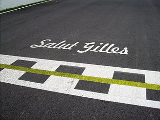 "Gilles Villeneuve - ""Salut Gilles"" sign at the Circuit Gilles Villeneuve start-finish line"