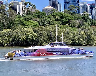 CityCat ferry passing the City Botanic Gardens at Gardens Point CityCat Gootcha (ship, 2010) in January 2019 in Brisbane.jpg
