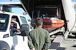 Coast Guard loads boat onto aircraft 140730-G-YE680-324.jpg