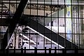 Couple on an escalator (24324429618).jpg