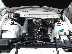 D24 engine bay of a 1990 volvo 240.JPG