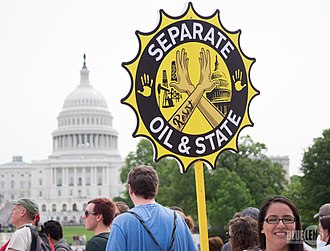 """Fossil fuels lobby - Placard """"Separate oil and state"""", at the People's Climate March (2017)."""