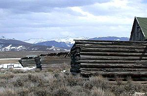 North Park (Colorado basin) - Log structure near Rand, Colorado, at the southern end of North Park. The view is southwards towards Willow Creek Pass.