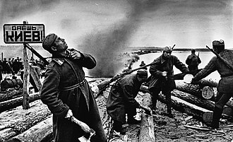 """Ukrainian Soviet Socialist Republic - Soviet soldiers preparing rafts to cross the Dnieper during the Battle of the Dnieper (1943). The sign reads """"To Kiev!""""."""
