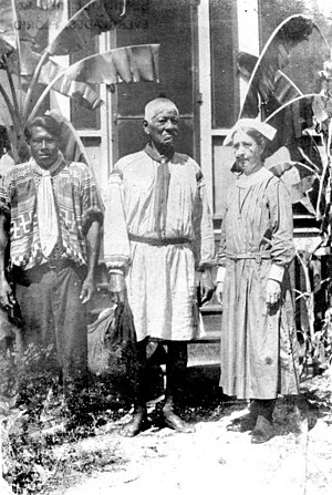 Harriet Bedell - Deaconess Bedell with a medicine man and Bobby Jim Tiger outside the Seminole mission
