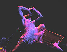 MC Ride and Zach Hill are seen performing live.