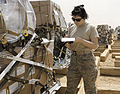 Defense.gov News Photo 110420-F-WP626-141 - Airman 1st Class Arielle Schultz inventories cargo at Al Asad Air Base Iraq on April 20 2011. The flight recently took on a commercial cargo.jpg