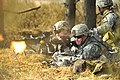 Defense.gov News Photo 120322-A-HE359-125 - U.S. Army Pvt. Ryan Slade left fires an M240 machine gun as Spc. Cody Branam fires his M4 carbine during a situational training exercise at the.jpg