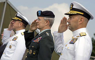 James G. Stavridis - U.S. Navy Admiral Mike Mullen, chairman of the Joint Chiefs of Staff, U.S. Army General John Craddock and U.S. Navy Admiral James G. Stavridis, incoming commander, salute during the national anthem at the U.S. European Command change of command ceremony at Patch Barracks in Stuttgart in June 2009