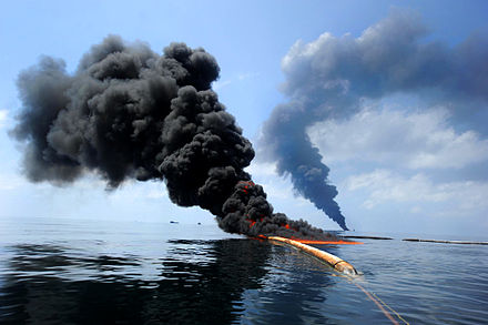 Dark clouds of smoke and fire emerge as oil burns during a controlled fire in the Gulf of Mexico, 6 May 2010 Defense.gov photo essay 100506-N-6070S-819.jpg