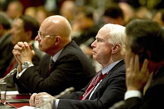 James Clapper - Clapper and Senator John McCain listen as Defense Secretary Gates addresses the audience, June 4, 2011