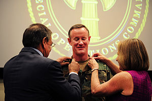 William H. McRaven - Defense Secretary Leon E. Panetta affixes Navy Adm. William H. McRaven's new rank as a four-star admiral along with McRaven's wife at a U.S. Special Operations Command ceremony at MacDill Air Force Base, Florida, August 8, 2011.