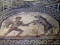 Detail of the Gladiator mosaic floor, a Venator fighting a leopard, Römerhalle, Bad Kreuznach, Germany (8196083327).jpg