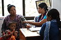 Devi Gurung recives a check-up at the Batulechaur Health Post's temporary location, Pokhara, Nepal (10691854073).jpg
