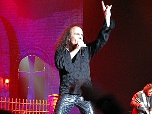 "Ronnie James Dio - Dio ""throwing horns"", a gesture commonly used by both artists and fans of heavy metal music"