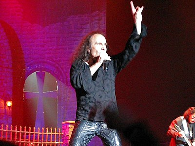 "Dio ""throwing horns"", a gesture commonly used by both artists and fans of heavy metal music Dio throwing Horns.jpg"
