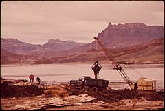 Dragline Basket and Claim Shell Bucket Are Used to Scoop Oil - Laden Debris from Log Boom on the San Juan River, 10-1972 (3814971580).jpg