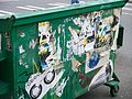 Dumpster with grafitti & posters.JPG