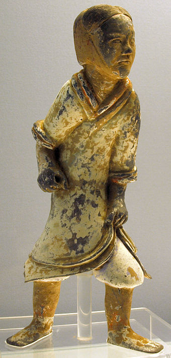 A Han dynasty era pottery soldier, with a now-faded coating of paint, is missing a weapon. EasternHan-ColouredPotteryFigurine-ShanghaiMuseum-May27-08.jpg