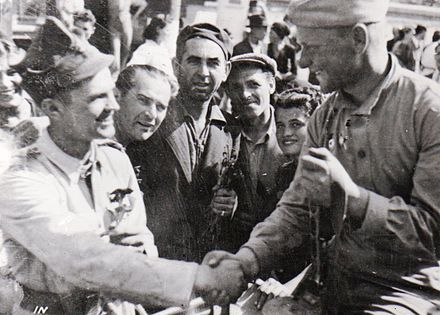 Romanian and Soviet soldiers shaking hands in Bucharest after the coup, 30 August EjercitoSovieticoEnBucarest1944.jpg