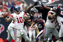 Eli Manning lines up a pass just out of the reach of Houston Texans  defenders in 2010. cfda151d0