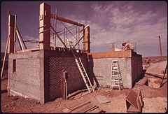 Exterior of an Experimental All Aluminum Beer and Soft Drink Can House Under Construction near Taos, New Mexico. (3815854018).jpg