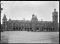 Exterior view of the Dunedin Railway Station, circa 1926 ATLIB 294041.png