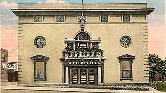 Richmond, Missouri - A historical postcard featuring the Farris Theatre.