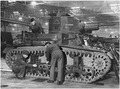 Fitters are at work assembling an American light tank which has just arrived at an English ordnance depot from the US... - NARA - 196324.tif