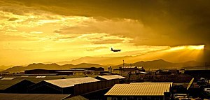 Shindand Air Base - Breaking dusk, a C-130 takes off from Shindand Air Base in 2012