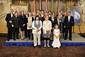 Former Secretary of Defense Donald H. Rumsfeld, fourth from left, and his wife, Joyce, sixth from left, take a family photo with their children and grandchildren during Rumsfeld's portrait unveiling ceremony at 100625-D-JB366-031.jpg