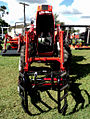 Front loader tractor with bale gripper.jpg
