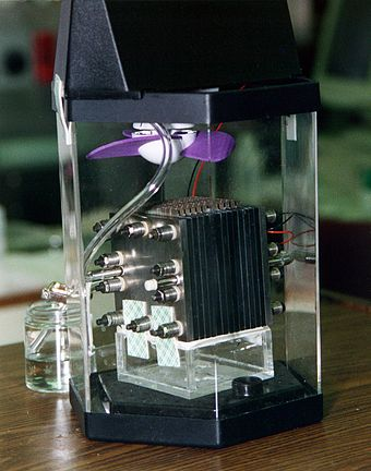 Demonstration model of a direct-methanol fuel cell. The actual fuel cell stack is the layered cube shape in the center of the image.