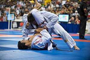 Brazilian jiu-jitsu - Romulo Barral (bottom) at the World Jiu-Jitsu Championship in Long Beach, California, attempts a triangle choke.