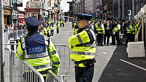 Crowd control - Garda Síochána officers on guard duty at a cleared street in Dublin, Ireland when President Obama visited the country in 2011.