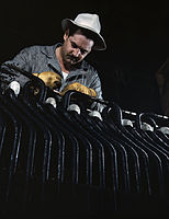 Generator works at the winding of a generator stator in a new addition to TVA's hydroelectric plant at Wilson Dam, Sheffield vicinity.jpg
