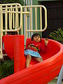 Girl Plays on Slide in Plaza La Candelaria - Valladolid - Yucatan - Mexico.jpg