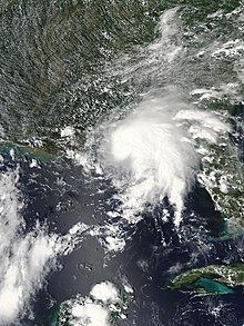 A visible satellite image of a tropical storm prior to making landfall near the Alabama–Mississippi border on September 4