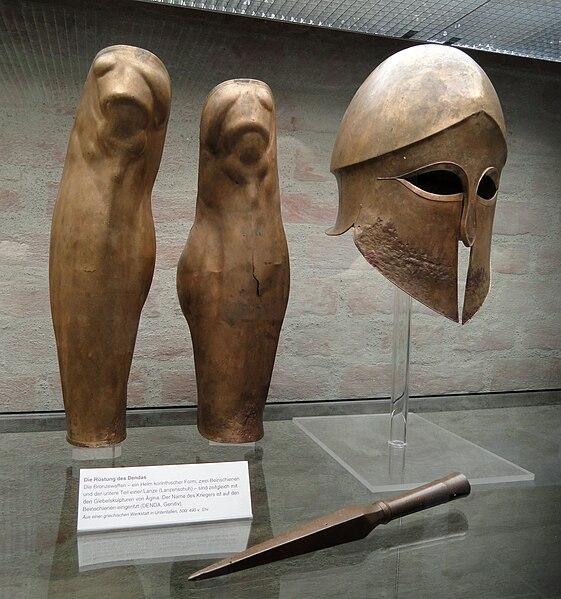 Greek Bronze Greaves, Helmet, and Spearhead